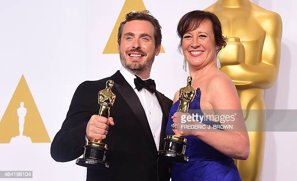 Winners for Best Animated Short Film 'Feast' Patrick Osborne and Kristina Reed pose in the press room during the 87th Oscars on February 22 2015 in...
