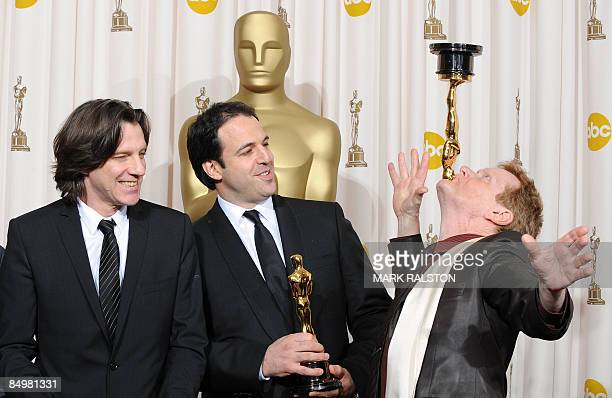 """Winners for Best Documentary Feature, """"Man on Wire,"""" James Marsh and Simon Chinn look on as French performance artist Philippe Petit plays with the..."""