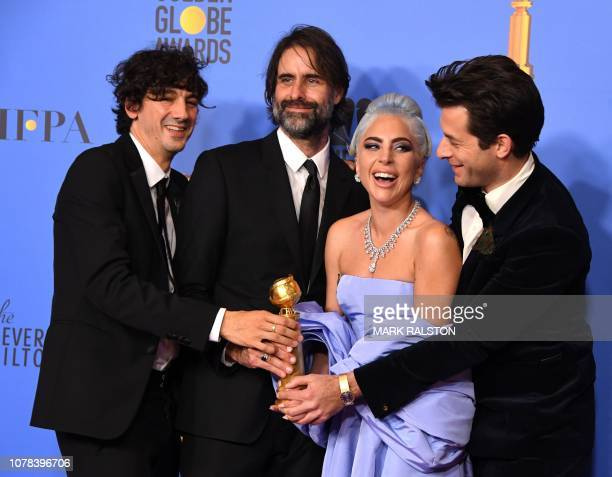 TOPSHOT Winners for Best Original Song Motion Picture for 'Shallow A Star is Born' Mark Ronson Lady Gaga Andrew Wyatt and Anthony Rossomando pose...