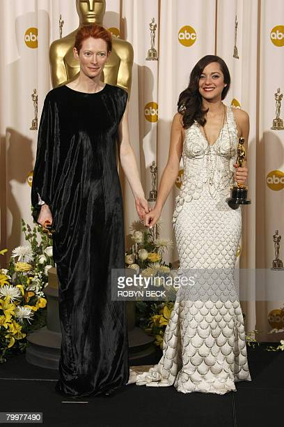 Winners for Best Supporting Actress Tilda Swinton and for Best Actress Marion Cotillard pose with their trophies during the 80th Annual Academy...