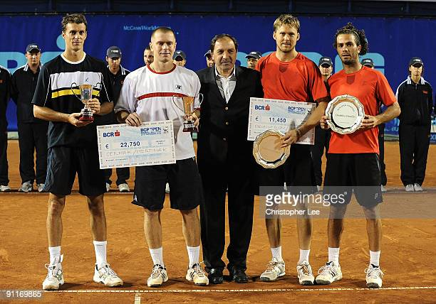 Winners Frantisek Cermak of Czech Republic and Michal Mertinak of Slovakia pose for the camera's with Johan Brunstrom of Sweden and Jean-Julien Rojer...
