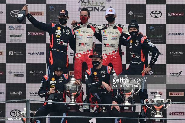 Winners French driver Sebastien Ogier and his co-driver Julien Ingrassia , second-placed Estonian driver Ott Tanak and co-driver Martin Jarveoja and...