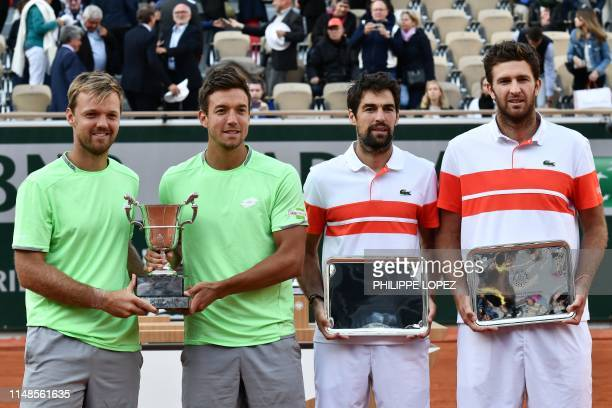 Winners Germany's Kevin Krawietz Germany's Andreas Mies secondplaced France's Jeremy Chardy and France's Fabrice Martin pose with their trophy at the...