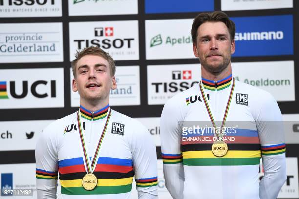 Winners Germany's Roger Kluge and Germany's Theo Reinhardt pose on the podium after taking part in the men's madison final during the UCI Track...