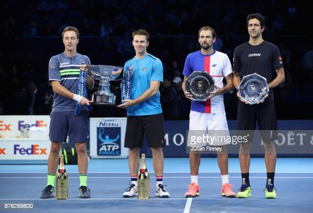 Winners Henri Kontinen of Finland and John Peers of Australia and runners up Marcelo Melo of Brazil nd Lukasz Kubot of Poland hold their trophies...
