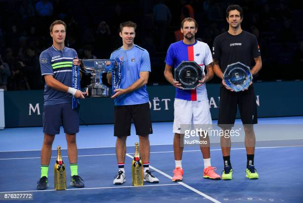 Winners Henri Kontinen of Finland and John Peers of Australia and runners up Marcelo Melo of Brazil and Lukasz Kubot of Poland hold their trophies...