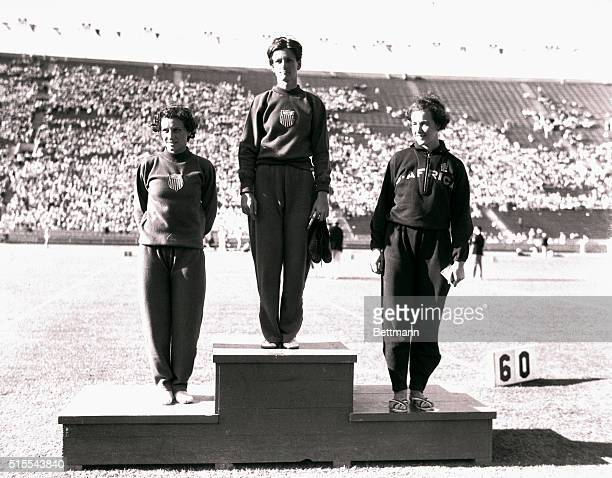 Winners in the 80meter women's hurdle event are seen after their victory in the Los Angeles Olympic Stadium Left to right Evelyn Hall of the US...