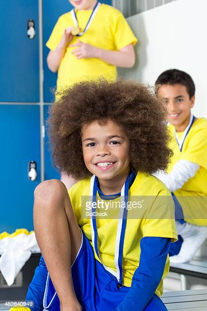 winners in the changing rooms - young boys changing in locker room stock pictures, royalty-free photos & images