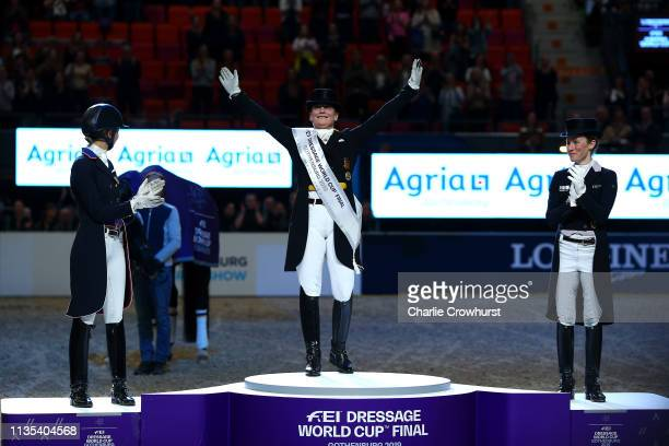 Winners Isabell Werth of Germany Laura Graves of USA and Helen Langehanenberg of Germany celebrate their placings during the Dressage Competition...