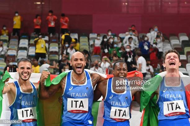 Winners Italia's teammates Lorenzo Patta, Lamont Marcell Jacobs, Eseosa Desalu and Filippo Tortu celebrate at the end of the men's 4x100m relay final...