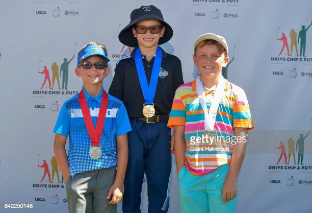 Winners Jack Forstein Luke Parsons and Davis Wotnosky of the Boys 79 Division of The Drive Chip and Putt Championship at Pinehurst Resort on...
