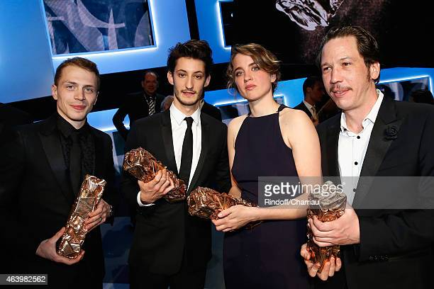 Winners Kevin Azais Pierre Niney Adele Haenel and Reda Kateb pose with their awards afterthe 40th Cesar Film Awards 2015 Ceremony at Theatre du...