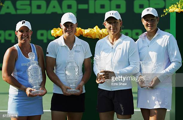 Winners Lisa Raymond and Samantha Stosur of Australia pose with their trophies next to Martina Navratilova and Leisel Huber of South Africa at the...