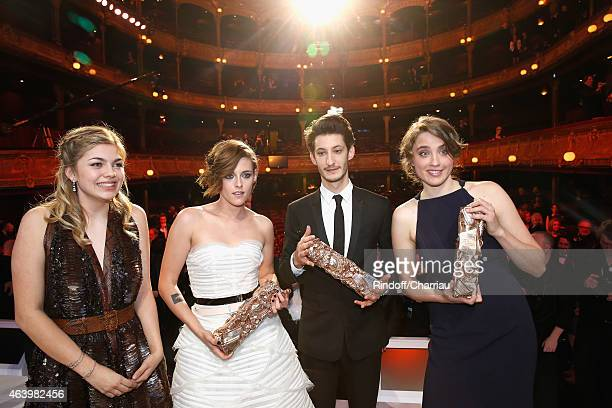 Winners Louane Emera Kristen Stewart Pierre Niney and Adele Haenel pose with their awards after the 40th Cesar Film Awards 2015 Ceremony at Theatre...