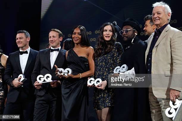 Winners Luke Evans Wotan Wilke Moehring Naomi Campbell William Liv Tyler and Bill Murray are seen on stage after the GQ Men of the year Award 2016...