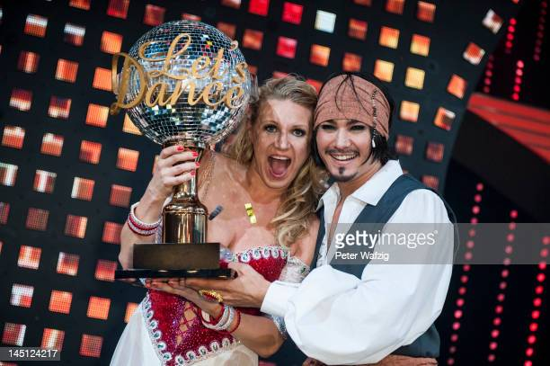 Winners Magdalena Brzeska and Erich Klann pose for the photographers after 'Let's Dance' Finals at Coloneum on May 23, 2012 in Cologne, Germany.