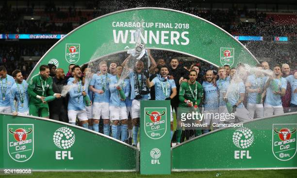 Winners Manchester City celebrate with the trophy during the Carabao Cup Final match between Arsenal and Manchester City at Wembley Stadium on...