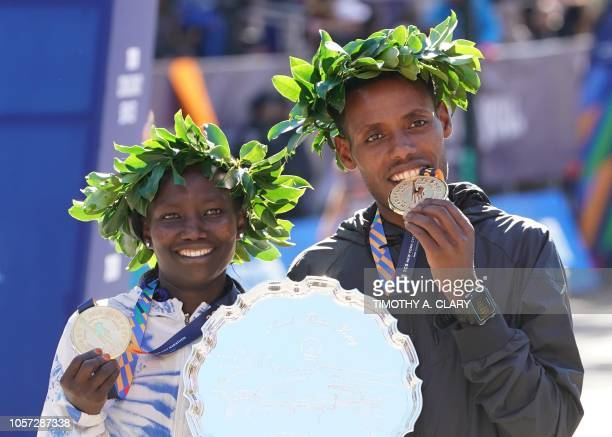 Winners Mary Keitany of Kenya and Lelisa Desisa of Ethiopia pose with ther medals during the 2018 TCS New York City Marathon in New York on November...