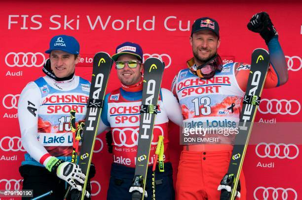 Winners Matthias Mayer of Austria second Beat Feuz of Switzerland first and Aksel Lund Svindal of Norway third celebrate their victories in the FIS...