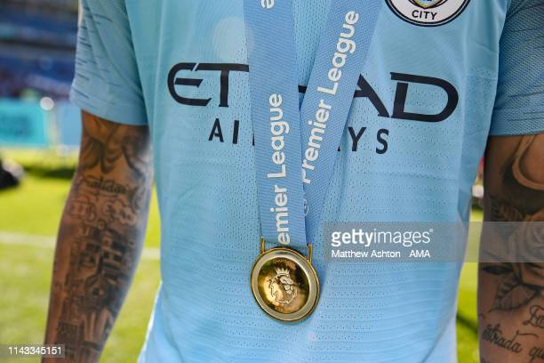Winners medal around the neck of a Manchester City player during the celebrations of becoming 2019 Champions after the Premier League match between...