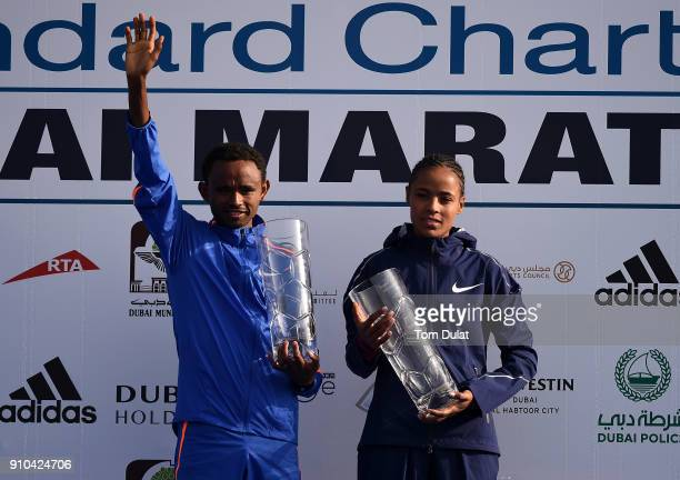 Winners Mosinet Geremew Bayih and Roza Dereje Bekele of Ethiopia pose for photographs after winning the Standard Chartered Dubai Marathon on January...
