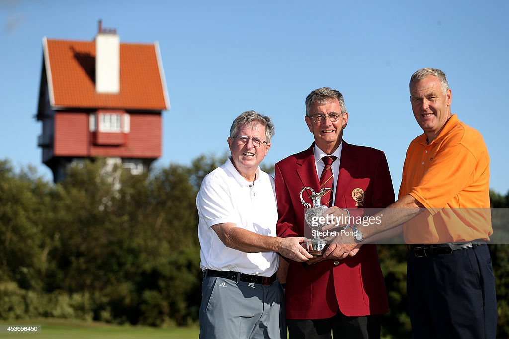 Winners Murray White (right) and Amateur John Griffin pose with PGA Captain Neil Selwyn-Smith and the trophy after day two of the PGA Super 60's Tournament at Thorpeness Hotel and Golf Club on August 15, 2014 in Thorpeness, England.