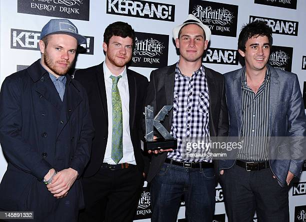 Winners of Best Live Band Peter Wafzig Rory Clewlow Rob Rolfe and Chris Batten of Enter Shikari pose in the Winners Area during the Kerrang Awards at...