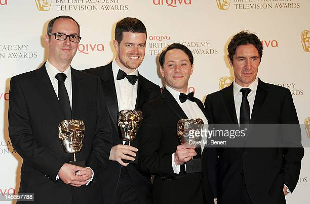 Winners of Best New Media Jon Aird Reece Shearsmith and Justin Davies of Psychoville pose with presenter Paul McGann in front of the winners boards...