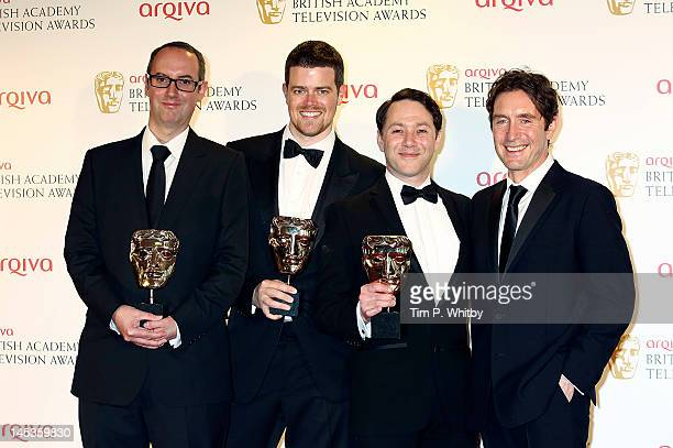 Winners of Best New Media Jon Aird Reece Shearsmith and Justin Davies of Psychoville and presenter Paul McGann pose in front of the winners boards at...