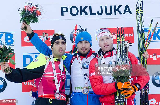 Winners of Biathlon World Cup 15km Mass Start Men on Pokljuka 2014 on podium. From left Martin Fourcade , Anton Shipulin and Simon Eder .