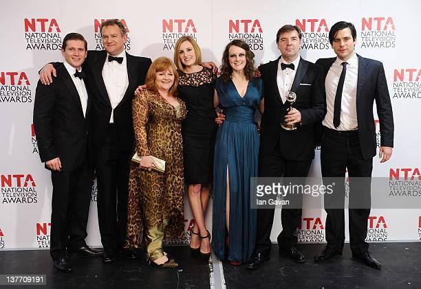 Winners of Drama Award Allen Leech Hugh Bonneville Lesley Nicol Laura Carmichael Sophie McShera Brendan Coyle Rob JamesCollier poses in the press...
