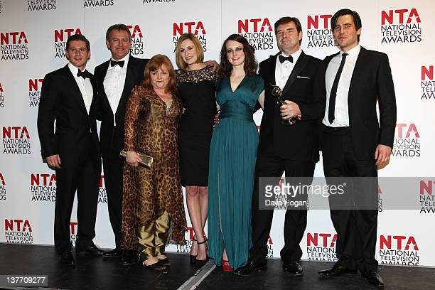 Winners of Drama Award Allen Leech Hugh Bonneville Lesley Nicol Laura Carmichael Sophie McShera Brendan Coyle and Rob JamesCollier pose in the press...