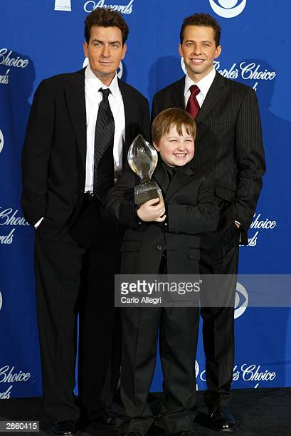 Winners of Favorite New Television Comedy the cast of Two and a Half Men Charlie Sheen Angus T Jones and Jon Cryer pose backstage during the 30th...