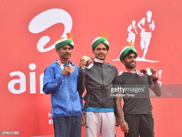 Winners of Indian Men Elite Marathon during the Airtel Delhi Half Marathon 2017 at JLN Stadium on November 19 2017 in New Delhi India Thousands of...