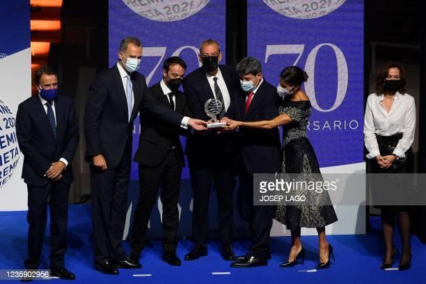 Winners of Spain's 2021 Premio Planeta award Jorge Diaz , Augustin Martinez and Antonio Mercero receives the trophy from Spain's King Felipe VI ,...