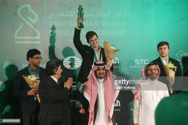 Winners of the 2017 World Rapid Blitz Championship receive their medals and trophies with Magnus Carlsen taking the gold medal in the blitz Anand...