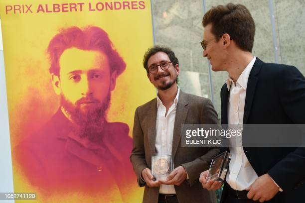 Winners of the Albert Londres prize JeanBaptiste Malet and Christophe Barreyre pose with their trophy during the Albert Londres award ceremony in...