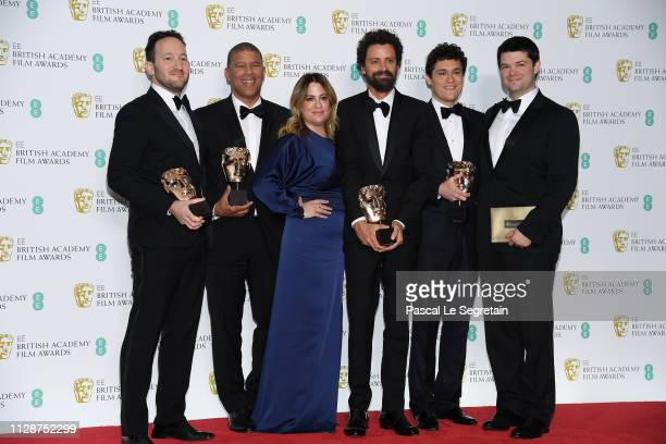 Winners of the Animated Film award for SpiderMan Into the SpiderVerse directors Rodney Rothman and Peter Ramsey Christina Steinberg director Bob...