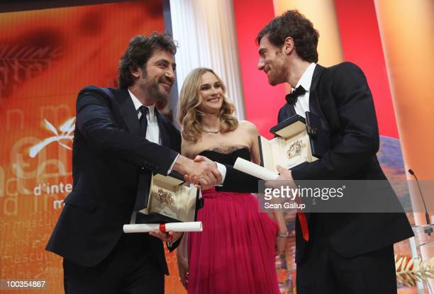 Winners of the award for Best Actor Javier Bardem and Elio Germano shake hands after winning as Diane Kruger looks on during the Palme d'Or Award...