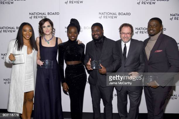 Winners of the Best Ensemble Award for Get Out Betty Gabriel Allison Williams Lil Rel Howery Stephen Root and Daniel Kaluuya pose with presenter...