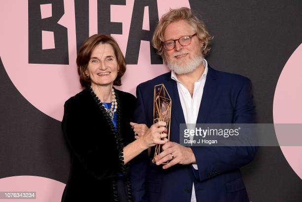 Winners of the Best Screenplay Award for 'The Favourite' Deborah Davis and Tony McNamara pose in the winners room at the 21st British Independent...