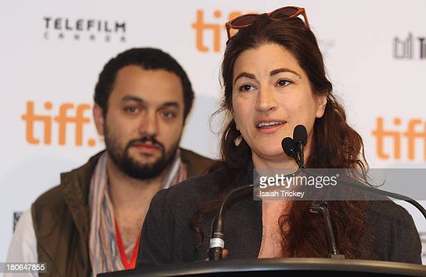Winners of the BlackBerry People's Choice Documentary Award for 'The Square' producer Karim Amer and director Jehane Noujaim attend the 2013 Awards...