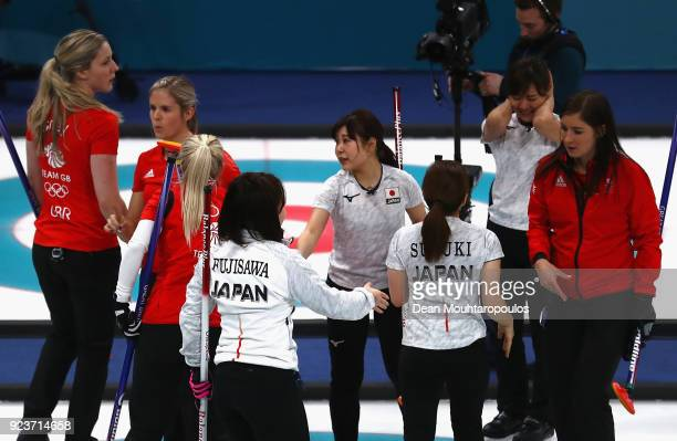 Winners of the Bronze medal Japan shake hands with Great Britain after the Curling Womens' bronze Medal match between Great Britain and Japan on day...