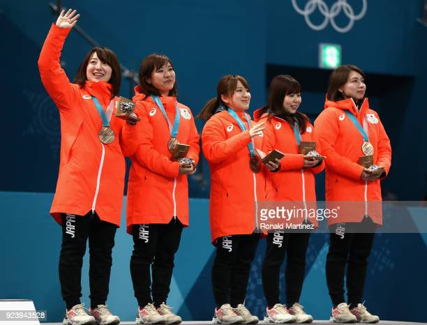 Winners of the bronze medal, Satsuki Fujisawa, Chinami Yoshida, Yumi Suzuki, Yurika Yoshida and Mari Motohashi of Japan celebrate on the podium...