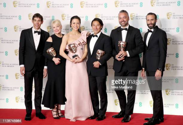 Winners of the Documentary award Alex Honnold Shannon Dill Elizabeth Chai Vasarhelyi Jimmy Chin Evan Hayes and presenter Joseph Fiennes pose in the...