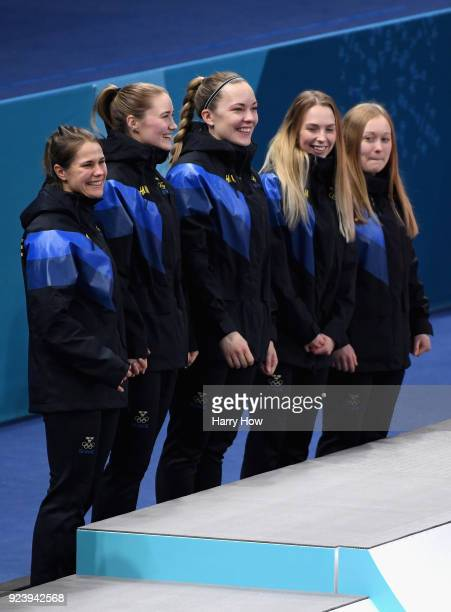Winners of the gold medal Jennie Waahlin Sofia Mabergs Agnes Knochenhauer Sara McManus and Anna Hasselborg of Sweden celebrate on the podium...