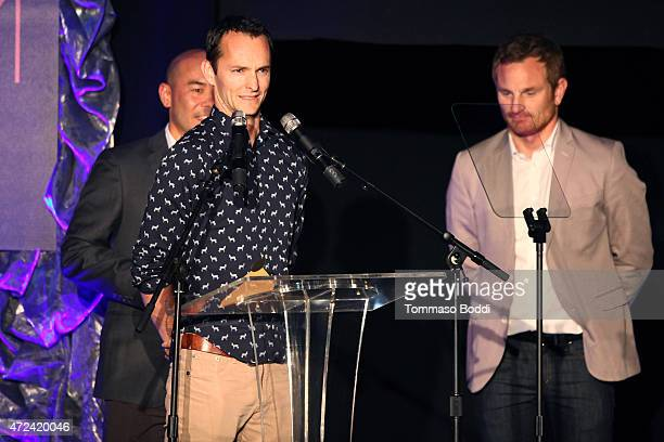 Winners of the Golden Trailer Award for Best Documentary Trailer creative director Scott Mitsui and editors Ryan Foster and Alex Lorge on stage...