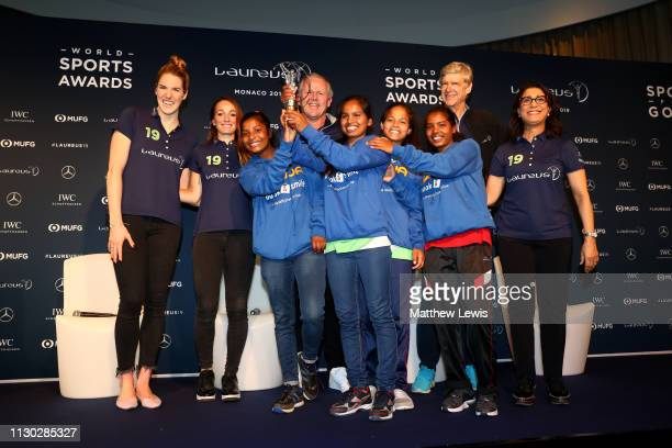 Winners of the Laureus Sport For Good Award Wumu Football teama football based indian charity pose with their trophy with Laureus Academy Member...