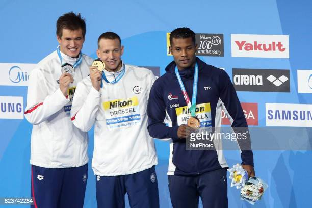 Winners of the men's 100m freestyle event at the 17th FINA World Championships in Budapest : Nathan Adrian -- silver medal, Caeleb Remel Dressel --...