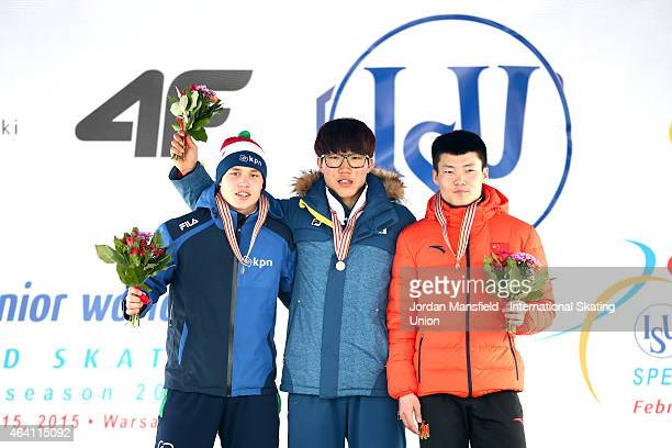 Winners of the Men's Mass Start Gold meadlist HyunMin Oh of Korea Silver medalist Marcel Bosker of the Netherlands and Bronze medalist Bin Zhou of...